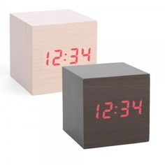 Mini Clap On Alarm Clock - Light Wood | Wood veneer with red LED digital time. Clap your hands or snap your fingers to make the time appear. Shop at SkyMall.com!