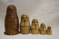 """Antique RARE Russian Nesting Dolls Matryoshka, circa 1910. Wonderful old unpainted nesting dolls. This is an example of a very early set. The book """"A Collector's Guide to Nesting Dolls"""" (pg 18), describes this style as """"unpainted with wood burned features. The wood has been left in its natural state—unstained and unvarnished. These early sets are most difficult to locate today. Rare."""""""