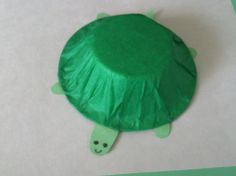The color of the week was green so we made a turtle.  Just cover a plastic bowl with green tissue paper and make the head, legs, and tail out of green construction paper.