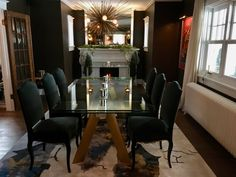 Our finished dinning room: Volubilis chairs, Chronos Anodise tempered glass table, and rug: Roche Bobois. Tempered glass console table: MFKTO.