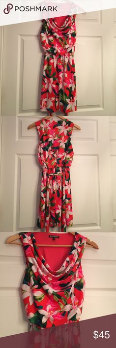 Floral Print Spring/Summer Dress Really beautiful dress with bright, fun colors! Light red dress with a floral print throughout. Loose neckline hangs in the front to show off neck and upper chest. Stretchy waist band to give a fitted look and nice shape. Comes with a wrap around tie at the waist that can be removed if desired. Worn one time to a horse race. Perfect for spring or summer, vacation dress, outdoor wedding etc. Express Dresses Mini