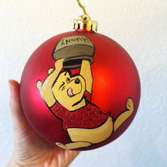 Winnie the Pooh desperately searches for more hunny on this adorable ornament. Personalization with name and year is complementary.  Thanks for