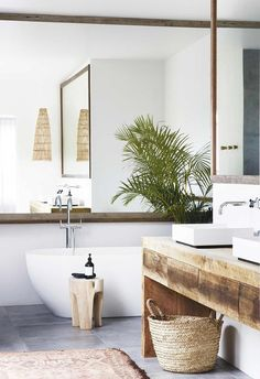 Master ensuite: The recycled timber vanity by Bernie & Co picks up the warm tones of the Tigmi Trading woven rug and Bisque Interiors stool. | Step inside this relaxed all-white Byron Bay home with upcycled details | Photography: Alicia Taylor #homeLivingRoom