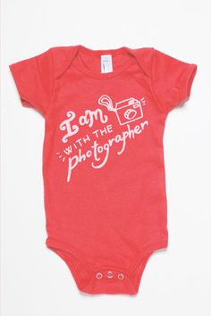 For the little photographer assistant - I am with the photographer onesie