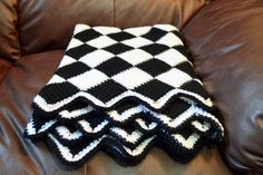Tunisian entrelac blanket (9-stitch squares (10 loops), two sc rows for border, with inc/dec for ripple..basically).