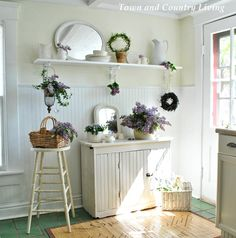 Colors: cool and warm whites (cream and lightly blue or grey tinted) green floor, wood mat, beadboard 2/3 way up the wall) Decorating with Lilacs - Town & Country Living