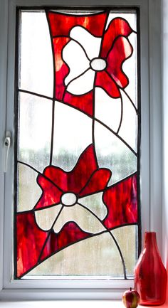 This window was created using the traditional method, with each piece of glass individually hand-cut and then leaded together. The design was based on a carved flower on the clients' ...