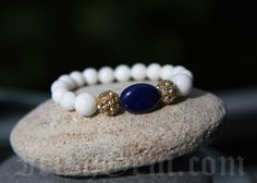 "Gemstone bracelet ""Côte d'Azur"" - Made of White Coral and Lapis Lazuli. Lapis Lazuli is a powerful aphrodisiac which brings harmony in relationships. Lapis Lazuli, Provence, Sapphire, Coral, Gemstones, Bracelets, Rings, Collection, Jewelry"