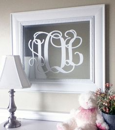 apply decal to mirror OR apply decal to picture frame and add fabric behind the glass