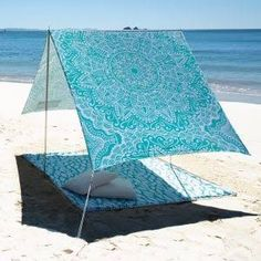 This is a beach tent. It's extremely useful to take to the beach to protect you from direct sunlight. This will prevent burning and even skin cancer. As you can see it is a tent like structure which has poles that go into the sand. There is a towel underneath the tent which you can relax on.