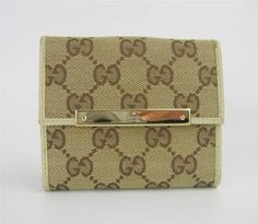 Gucci Brown Small Card Wallet Coin Purse Jacquard GG Monogram Canvas. Get the lowest price on Gucci Brown Small Card Wallet Coin Purse Jacquard GG Monogram Canvas and other fabulous designer clothing and accessories! Shop Tradesy now