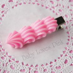 Adorbs... precious little hair clip that looks like piped pink icing! <3