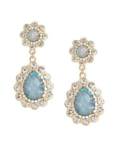 Go feminine and flirty with this striking set of earrings. They flaunt a beautiful floral motif, crafted from dazzling, deluxe gems, and petaled diamond finery.