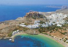 the Acropolis of Lindos, Rhodes (seen on top of the hill while all around the hill there are the ruins of the ancient city of Lindos), Greece Beautiful Places To Visit, Wonderful Places, Cool Places To Visit, Places To Travel, Places To Go, Greek Islands To Visit, Greece Islands, Mykonos, Greece Rhodes
