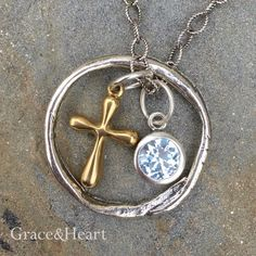 Grace&Heart's Eternity Circle, Brass Bubble Cross Charm, and Fiery Birthstone Charm brilliantly displayed on a Sterling Silver Twisted Cable Chain Tina.GraceandHeart@gmail.com #GraceandHeart