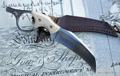 Beautiful looking knife. I love the hawkbill blade style knives.