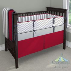 Solid Navy, Solid Red, Gray and White Polka Dot used in crib bedding created with the Nursery Designer by Carousel Designs. Mix and match hundreds of fabrics to create your own unique baby bedding.