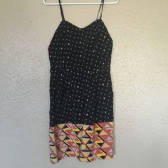 Black patterned dress This black is light weight and comfy! It has this straps that are adjustable and a gold zipper on the back. Great dress for summer or fall! In great condition. From target size M Xhilaration Dresses