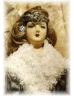A Boudoir Doll Silver Coat and Head Piece