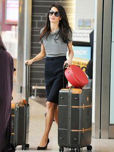 Amal Clooney wears a plaid blouse, pencil skirt, and black pumps