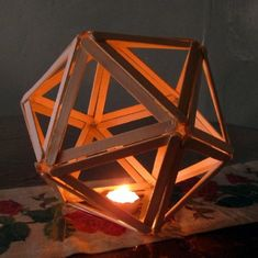 In geometry, an icosahedron is a regular polyhedron with 20 identical equilateral triangular faces, 30 edges and 12 vertices. It is one of the five Platonic solids. ^^ CLIK PIN FOR MORE INFO ^^ Popsicle Stick Crafts Craft Stick Projects, Craft Stick Crafts, Wood Crafts, Fun Crafts, Diy And Crafts, Crafts For Kids, Arts And Crafts, Craft Sticks, Craft Ideas