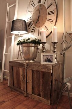09 a simple rustic wooden cabinet and a large clock create a cozy farmhouse space - Shelterness