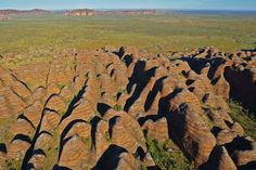 The Bungle Bungles in Purnululu National Park are mystical striped domes and ruby red gorges carved by the torrential rains that flood the Kimberley Region. Road Trip Destinations, Western Australia, Geology, Mystic, Moose Art, National Parks, World, Beach, Amazing