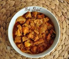 Pork Bafat- a pork dish made with spices and served with Sannas or Rice. Goan Recipes, Veg Recipes, Indian Food Recipes, Ethnic Recipes, Pork Curry, Curry Spices, Pork Dishes, Tamarind, Chana Masala