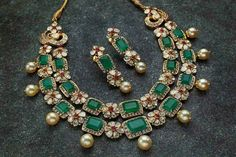 Beautiful emerald, ruby and pearl embellished gold necklace and earrings