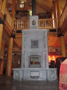 A Tulikivi Fireplace: the Warm Heart of an Iraq War Vet's Washington Log Home Cabin Ideas, House Ideas, Wood Stoves, Wood Fired Oven, Iraq War, Rocket Stoves, Fire Places, Soapstone, Log Homes