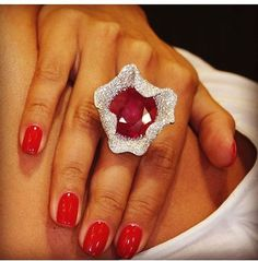 Palmiero. A wonderful African ruby is captured by a fine white diamond pavé. #Palmiero #jewellery #ring #ruby #diamonds #art #jewelry #italianjewelry #madeinitaly #vicenzaoro #hautecouture: