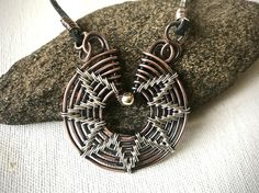 A personal favorite from my Etsy shop https://www.etsy.com/listing/571773648/wire-wrapped-mixed-metal-pendant