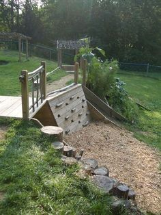 Kid friendly garden ideas... LOVE the climbing wall part. Maybe we can add this to a fence?