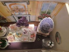 """Nov. 30, 2014 - This overhead view shows the """"hat"""" portion of the scene and now we move to the center of the display where the large white table sits with its gift boxes and flowers.  Note the design of the back """"wall."""""""