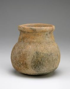 Vessel with round bottom and overall paddle-impressed texture      Earthenware     16 x 16 cm     Ban Chiang culture     3600-1000 B.C.E., Ban Chiang culture, early period, phase 4     Origin: Northeast Thailand