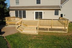 Large Custom Wood Deck in Solon with Benching & Large Steps Inviting You To the Patio. Latice Work To Add That Sweet Finishing Touch