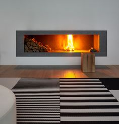 A stunning moment. Just the smooth warmth of the fire and cosy feeling. Woodnotes Big Stripe and Stripe carpets with the Squareplay combo. Striped Carpets, Black And White Interior, Interior Decorating, Interior Design, Scandi Style, Winter House, Luxury Homes, Minimalism, Sweet Home