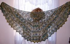 A Shawl for Jane is crescent shaped, beginning at top center back and worked down and outward. The shawl was designed to highlight highly variegated yarns through two lacy chevron patterns. Garter rows provide texture. An expanding center panel continues the chevron patterns and accentuates the flattering drape of this shawl.