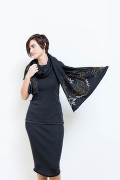 """Our Dylan Wrap Scarf features intricate hand embroidery in a floral design. Layer it over a basic look to add texture and interest. It is made in a single layer of 100% organic medium-weight cotton jersey. • Measures 22"""" wide and 72"""" long  • Choose your colorway below; one size  • Wash gently + Hang to dry  • Hand made in the USA  • Please allow three to six weeks for delivery"""