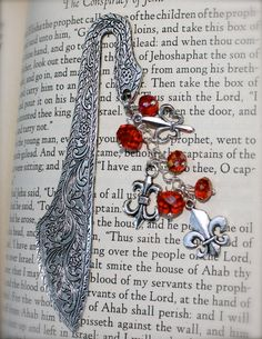 Items similar to Handcrafted Bookmark on Etsy, Fleur De Lis and Red Swarovski Crystal Bookmark, by Okrrah on Etsy Wire Bookmarks, Book Marks, Book Covers, Christmas Ideas, Swarovski Crystals, Spaces, Unique Jewelry, Handmade Gifts, Books