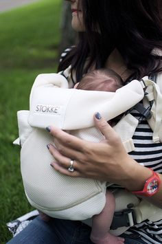 Stokke carrier. Proper carrier support for baby's developing hip joints and spine.