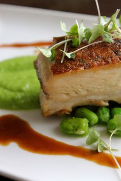 slow roast pork belly with broad beans, pea puree, and calvados ...
