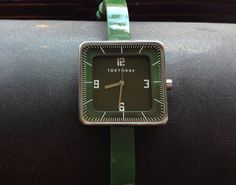 Gala Watch in green. Simple square watch face with patent leather green skinny watch band.