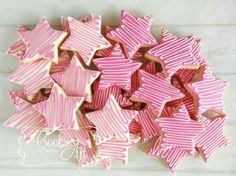 "Twinkle Twinkle Little Star Cookies. We could change them to purple and put an ""S"" in the center."
