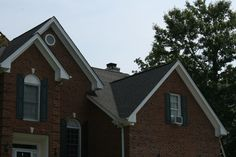 Durham Roofing | After photo of a re-roofing project using a CertainTeed Landmark shingle in Moire Black.