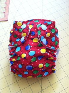 This is a simple, step-by-step tutorial for sewing a basic all-in-one (AIO) cloth diaper. This diaper uses hidden PUL, so you can have a cute...