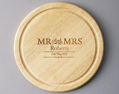 Personalised Couples Chopping Board - Mr & Mrs  £20.00 Round chopping board with personalised engraving. Personalise with a couple's surname up to 15 characters and a date up to 20 characters. 25cm diam.