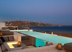 Villa Genesis at Mykonos is available for rent, and located in the prime area of Aleomandra, facing the deep blue waters of the Aegean sea. Villa Genesis is impeccably designed to combine modern style with traditional Mykonian architecture Luxury Villas In Greece, Mykonos Town, Hotel Services, Pool Maintenance, Beautiful Villas, Komodo, Lounge Areas, Night Life, Living Rooms