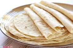 Soft, tender Homemade Flour Tortillas are deliciously versatile and surprisingly easy to make with just a few simple ingredients! Wellllll...it's only natural that I follow up last week's Easy Spanish Rice recipe with some Easy Homemade Flour Tortillas, right? ;) I'm still feeling in a Cinco de Mayo-inspired mood, but the good news is that these flour tortillas are fantastic any day of the year! Have you ever made your own homemade tortillas before? It might sound intimidating, bu...