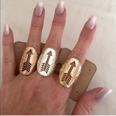 2/$20 Cutout Arrow Ring PRICE IS FOR ONE RING. Choose from aged copper-ish tone, silver tone, gold tone. Stretch band can be scene in image 4. All images show examples of actual stocked rings. Brand new and on card. No holding, no trades, no offsite payment. All $12 jewelry is two for $20. ⚠️CONFIRM COLOR AVAILABILITY PRIOR TO PURCHASE       PRICE IS FIRM UNLESS BUNDLED       No offers entertained for any reason Jewelry Rings
